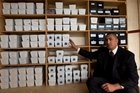 Nick Bakulich describes the 164 unclaimed boxes of ashes at his business as 'the forgotten society'. Photo / Brett Phibbs
