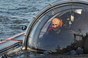 Presidnet Vladimir Putin took to a small submarine to explore the wreck of a 19th century frigate. Photo / AP