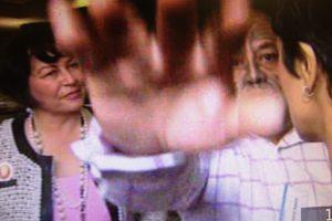 Dr Wayne Ngata's hand allegedly pushing the camera. Image / Te Karere