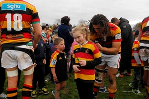 Abby Devane, 9, gets her top signed by Waikato's Josaan Levien yesterday. Photo / Christine Cornege