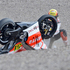 Ducati rider Michele Pirro of Italy kneels behind his bike after crashing during the MotoGP free practice at the German GP. Photo / AP
