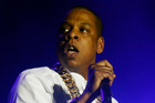 Jay Z says he and Kanye West fought for four days over two songs that appeared on the rapper's new album. Photo / AP