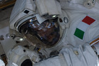 European Space Agency astronaut Luca Parmitano works on the International Space Station before a helmet leak caused concern. Photo / AP