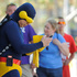 "Gene Ross, left, of Chula Vista, Calif., dressed as ""Cyclops,"" checks his cell phone as he stands outside the 2013 Comic-Con International Convention. Photo / AP"