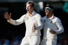 Australia's Steven Smith, left, celebrates the wicket of England's Matt Prior during the Ashes test at Lord's cricket ground in London. Photo / AP