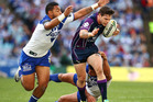 Sam Perrett and Krisnan Inu of the Bulldogs tackle Ben Hampton of the Storm during the round 18 NRL match between Canterbury Bulldogs and the Melbourne Storm. Photo / Getty Images.