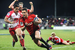 Dan Carter scores a try with team mate Wyatt Crockett celebrating behind, Ben Tapuai of the Reds and during the Super Rugby match between the Crusaders and the Reds. Photo / Getty Images.
