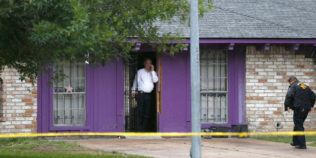 Police say four homeless men were found in deplorable conditions in this house. Photo / AP