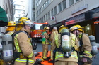 Firefighters at the scene of the office fire in Wellington. Photo / APNZ