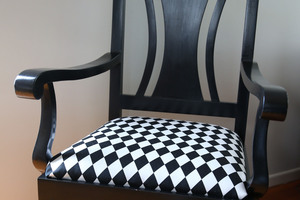 An old chair, is given a modern finish in black and white. Photo / Doug Sherring