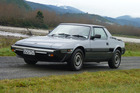 The Fiat X1/9. It's a car where you sit low with the engine right behind your head. Photo / Jacqui Madelin