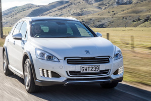 Peugeot's 508 RXH sportswagon is powered by a hybrid diesel engine and has stunning 'claw' front LED lights