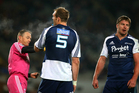 After a big-screen review, referee Chris Pollock, left, red-cards Blues blindside flanker Kane Barrett, right. Photo / Getty Images