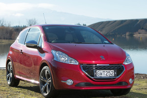 The old 205 GTi (far left) and the Peugeot GTi that has just been launched in NZ.
