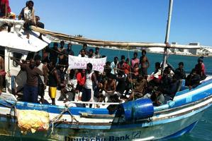 A boat carrying asylum seekers pulls into Geraldton, near Perth.