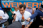 New York City mayoral hopeful Anthony Weiner discusses his policies with a passerby while greeting commuters during a campaign event outside a Harlem subway station. Photo / AP