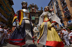 Pamplona Giants, a San Fermin Comparsa group, dance in Plaza Ayuntamiento square. Photo / AP