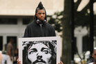 Arion Lewis carries a poster at a protest in Jacksonville. Photo / AP