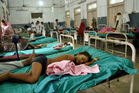 Indian children who fell sick after eating a free school lunch lie at a hospital in Patna, India. Photo / AP