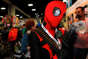 Jonah Duhe, dressed as Marvel mercenary Deadpool, waits in line during the Preview Night event on Day 1 of the 2013 Comic-Con International Convention. Photo / AP