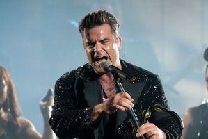 Singer Robbie Williams performs with his band in Gelsenkirchen, Germany. Photo / AP