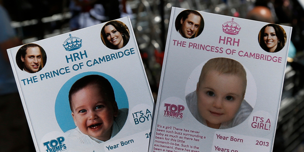 Cards depicting the 'royal baby' either as a boy or a girl, specially made by a games company as a publicity stunt outside the hospital where media are waiting for Kate to give birth. Photo / AP
