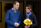 Prince William stands next to his wife Kate, Duchess of Cambridge. Photo / AP