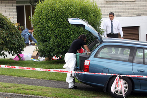 Police at the scene of the murder in Tauranga. Photo / APN