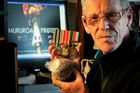NZ Navy veteran Wayne O'Donnell  shows his navy medals and half of a cancerous tumour taken out of his body. Photo / Warren Buckland