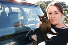 Amy King and her car-surfing cat Lilly.  Photo / John Stone