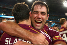 Maroons captain Cameron Smith celebrates with team mate Billy Slater after winning game three of the series between the New South Wales Blues and the Queensland Maroons. Photo / Getty Images.