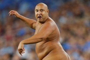 Wati Holmwood tears off down the field naked during the State of Origin game. Photo / Getty