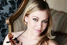 Viola player Julia Joyce is the new poster girl for the New Zealand Symphony Orchestra.