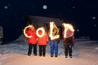 The message, written with sparklers says it all in <i>Antartica: A Year On Ice</i>