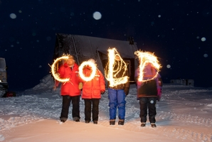 The message, written with sparklers says it all in  Antartica: A Year On Ice