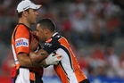 A groggy Benji Marshall (left) receives attention from the trainer. Photo / Getty Images
