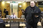 John Key and Kim Dotcom are at odds about whether spying on Dotcom by the GCSB would be lawful or not under proposed changes to the law. Photo / Mark Mitchell