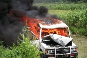 A vehicle set alight by demonstrators protesting the deaths of schoolchildren at a school in the Saran district of Bihar state. Photo / AFP