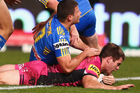 Kevin Kingston scores against the Eels. Photo / Getty Images
