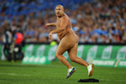 A streaker runs onto the field during the game between the New South Wales Blues and the Queensland Maroons. Photo / Getty