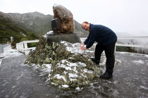 Rimutaka Hill Road open after two light falls closed it at 6.30 and again at 7.30 this morning. People stopped at the summit to play in the snow. Daniell Melville of Hamilton has never been in the snow before and made a snowman to celebrate it..