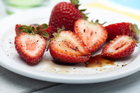 Strawberries with vinegar? Make your own fruit-flavoured vinegar at home.  Photo / Thinkstock