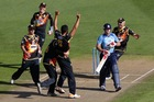 Malaesaili Tugaga is congratulated after taking the wicket of Lou Vincent in the first ball of the Auckland innings. Photo / Getty Images