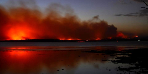 A fire burns near Sussex Inlet in Australia. Photo / New South Wales Rural Fire Service/AP