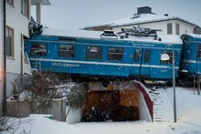 The derailed train that hangs on the edge of the track after it crashed into the side of a residential building in Saltsjobaden outside Stockholm. Photo / AP
