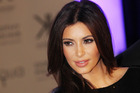 Kim Kardashian says jokes about her divorce don't work because technically she's still married. Photo / AP