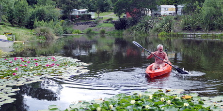 Alan Mitchell tries out the kayak at the Hawkes Bay Naturist club. Photo / Paul Taylor