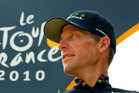 In this July 25, 2010, file photo, Lance Armstrong looks back on the podium after the 20th and last stage of the Tour de France. Photo / AP.
