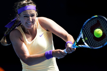 Victoria Azarenka of Belarus hits a return to Jamie Hampton of the US during their third round match at the Australian Open tennis championship in Melbourne. Photo / AP