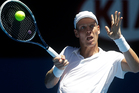 Tomas Berdych of the Czech Republic hits a forehand return to France's Guillaume Rufin during their second round match at the Australian Open tennis championship. (AP Photo/Dita Alangkara)